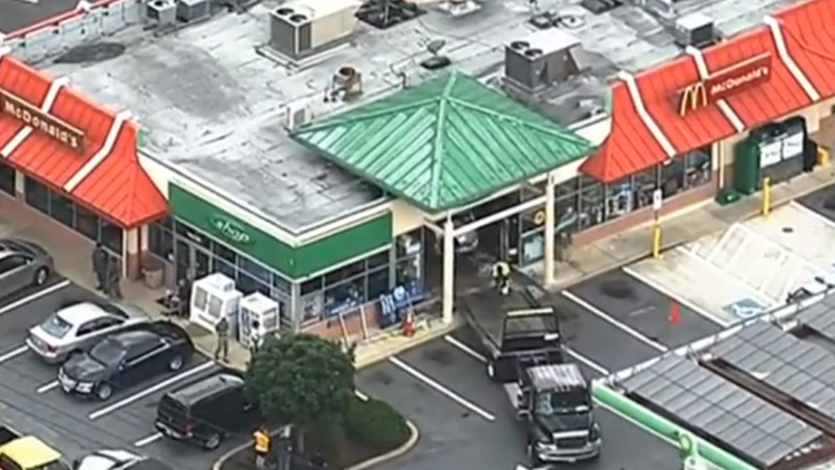 Van drives into gas station in Gaithersburg. 4 people are being evaluated