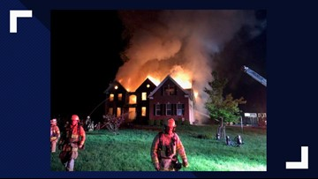Family escapes 2-alarm house fire by jumping out of window