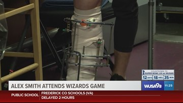 Alex Smith shows off massive brace in visit with Wizards
