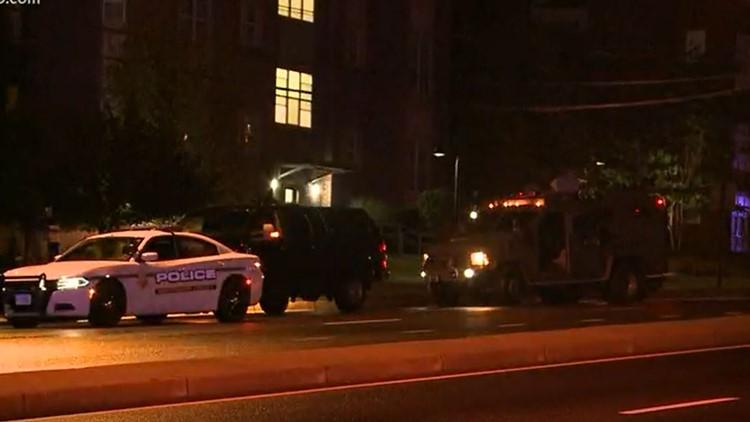 Police: Man in custody after firing gunshots from apartment balcony