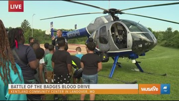 Campers meet and greet with a helicopter pilot at the Battle of the Badges blood drive