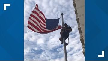 Navy SEAL climbs pole to fix American flag at Virginia Beach monument