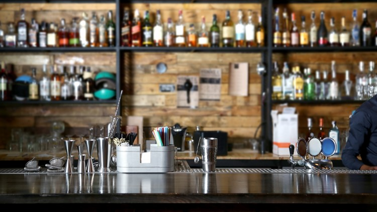 Northam rolls back restrictions on bar seating