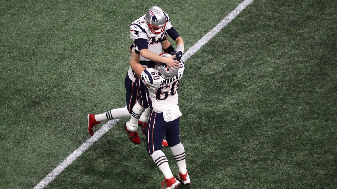 Tom Brady  12 of the New England Patriots is congratulated by his teammates  David Andrews  60 and Brian Hoyer  2 after their fourth quarter touchdown  ... ab464603b
