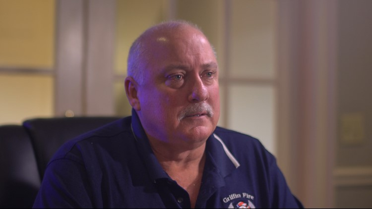 Rick Rickerson, a retired fire chief, said he saved a woman's life and then was handcuffed and arrested for not moving his truck. (Brendan Keefe / WXIA)